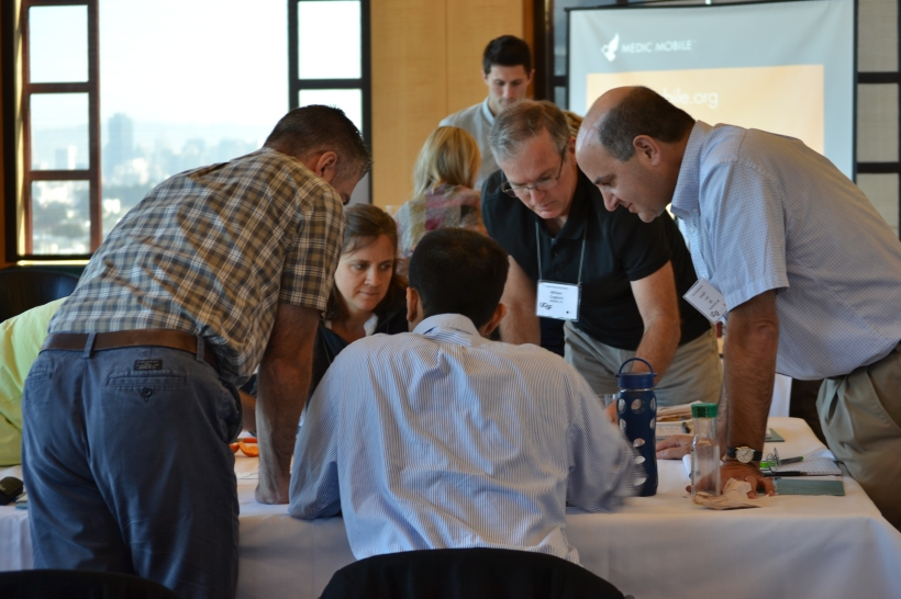Participants work together to map a health system during Josh Nesbit's presentation on Mobile Technology.